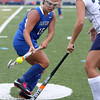 KEN YUSZKUS/Staff photo  Danvers' Erica Haibon, left, brings a high ball under control and Peabody's Taylor Colella swoops in during the Danvers at Peabody field hockey game.      09/06/16