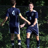 DAVID LE/Staff photo. Swampscott captain Mike Coffey, left, runs over to greet fellow captain Jack Herlihy, right, after Herlihy tied the game at 1-1 against Danvers. 9/8/16.