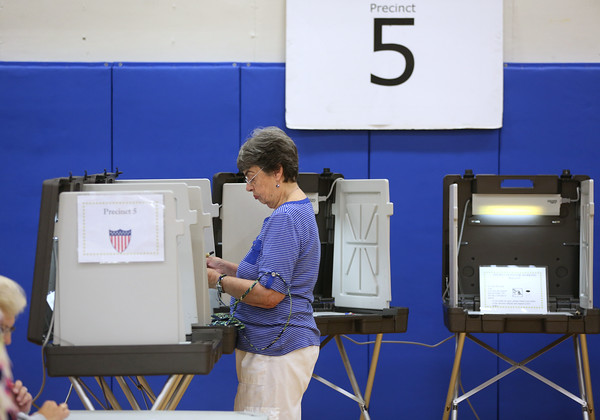 KEN YUSZKUS/Staff photo   Louise Sillars of the 5th precinct votes at the Vye gym at Danvers High School.    09/08/16