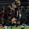 DAVID LE/Staff photo. Peabody midfielder Jillian Arigo (25) carries the ball upfield against Danvers. 9/20/16.