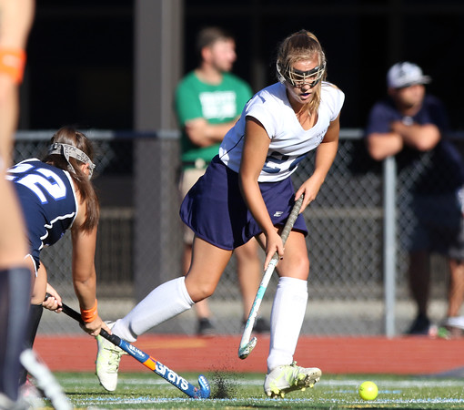 DAVID LE/Staff photo. Peabody's Mallory LeBlanc plays the ball past the outstretched stick of Swampscott's Mackenzie Carrol (22). 9/15/16.