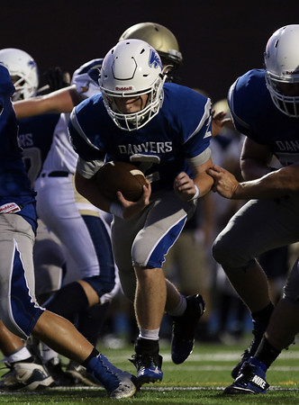 DAVID LE/Staff photo. Danvers junior Justin Mullaney (2) scampers in for an 11-yard touchdown in the first half against Winthrop on Friday evening. 9/9/16.