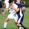 DAVID LE/Staff photo. Danvers' back Spencer Persson (12) gets fouled by Swampscott's Dan Johnson as they battle for the ball. 9/8/16.