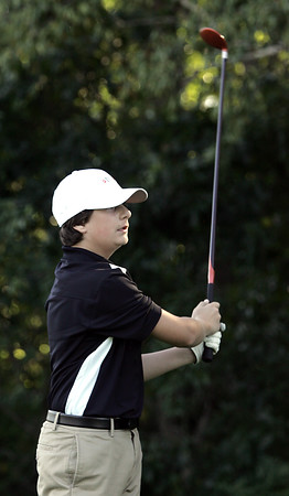 KEN YUSZKUS/Staff photo.     Ipswich's Bobby Grady watches his ball after teeing off toward the 3rd hole during the Ipswich at Hamilton-Wenham golf match.    09/12/16