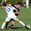 DAVID LE/Staff photo. Swampscott's Mike Coffey tries to get past Danvers' Spencer Persson (12). 9/8/16.