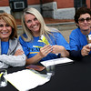 HADLEY GREEN/Staff photo<br /> From left, Stephanie McGeney, Cathy Geomelos and Carla Scheri, all of Peabody, run the admissions table at Peabody's block party on Chestnut Street next to City Hall. <br /> 09/08/17