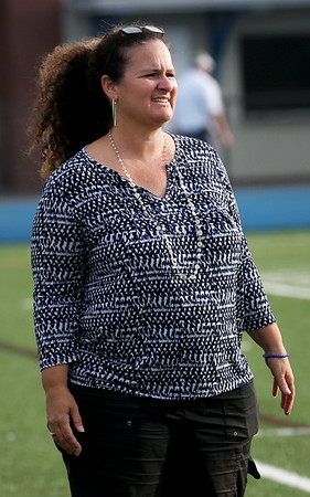 HADLEY GREEN/Staff photo<br /> Danvers field hockey coach Jill McGinnity watches the Danvers v. Bishop Fenwick game at Danvers High School.<br /> 09/21/17