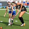 HADLEY GREEN/Staff photo<br /> Danvers' Kelley Marmen (6) and Bishop Fenwick's Courtney Muir (4) vie for the ball at the Danvers v. Bishop Fenwick girls field hockey game at Danvers High School.<br /> 09/21/17