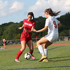 HADLEY GREEN/Staff photo<br /> Salem's Angela Berry (4) dribbles while Beverly's Klaudia Rushi (9) plays defense at the Beverly v. Salem girls varsity soccer game held at Beverly High School.<br /> 09/07/17