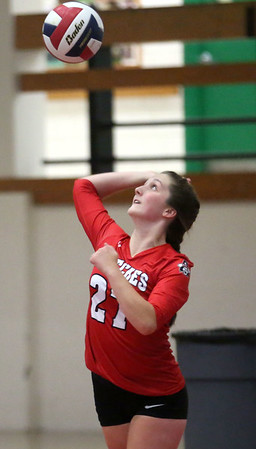 HADLEY GREEN/Staff photo<br /> Salem captain Briana Sano (21) serves the ball at the Salem High v. Peabody High girls varsity volleyball game held at the Salem High School field house.<br /> <br /> 09/06/17