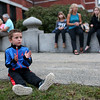 HADLEY GREEN/Staff photo<br /> Sawyer La Vita, 4, claps for Red Square during their set at Peabody's block party on Chestnut Street next to City Hall. <br /> 09/08/17