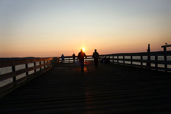 HADLEY GREEN/Staff photo<br /> People walk towards the end of the pier at the Willows to fish at sunrise.<br /> <br /> 08/31/17