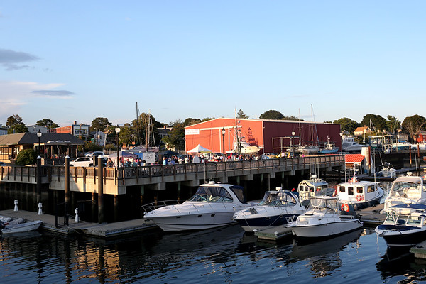 HADLEY GREEN/Staff photo<br /> Food vendors, community groups, and ocean activities filled Glover Wharf Marina at the Beverly Harbor Fest on Thursday evening. 09/09/17