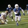 HADLEY GREEN/Staff photo<br /> Danvers' John Strangie (33) runs towards the end zone after intercepting the ball at the Danvers v. Malden boys varsity football game at Danvers High School.<br /> 09/30/17