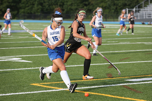 HADLEY GREEN/Staff photo<br /> Danvers' Erica Haibon (15) runs with the ball while Bishop Fenwick's Courtney Muir (4) plays defense at the Danvers v. Bishop Fenwick girls field hockey game at Danvers High School.<br /> 09/21/17