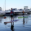 HADLEY GREEN/Staff photo<br /> People paddle board in Beverly Harbor during the Beverly Harbor Fest.<br /> 09/09/17