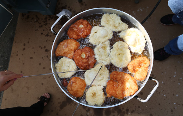 HADLEY GREEN/Staff photo<br /> Fernanda Sioveira makes fried dough at the International Festival in Peabody.<br /> 09/10/17