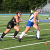 HADLEY GREEN/Staff photo<br /> Bishop Fenwick's Nicole Modica (13) and Danvers' Mackenzie Schmink (10) run for the ball at the Danvers v. Bishop Fenwick girls field hockey game at Danvers High School.<br /> 09/21/17