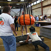 HADLEY GREEN/Staff photo<br /> A pumpkin is placed on the scale at the Giant Pumpkin Weigh-Off at the Topsfield Fair.<br /> 09/29/17