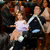 "RYAN HUTTON/ Staff photo<br /> Beverly native and ALS sufferer Pete Frates enters the State Street Pavilion at Fenway Park on Monday night with his daughter Lucy, 3, in his lap for an event to support the book about him ""The Ice Bucket Challenge"" - a chronicle of his struggles with ALS and how he helped start the famed ice bucket challenge to raise money for ALS research."