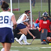 HADLEY GREEN/Staff photo<br /> Peabody's goalie Sofia Rodriguez makes a save at the Peabody v. Marblehead girls varsity field hockey game at Peabody High School.<br /> 09/26/17