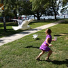 HADLEY GREEN/Staff photo<br /> Patton Labbe, 5, of Salem, runs away from seagulls as she eats at the Willows park in Salem.<br /> <br /> 09/01/17