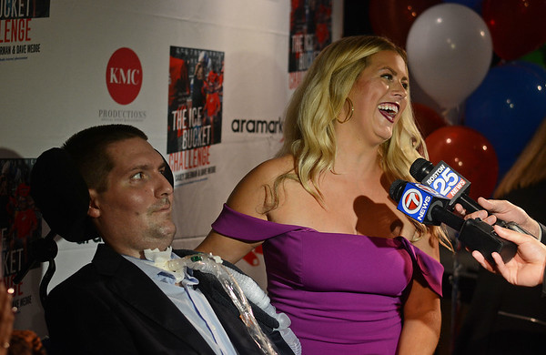 """RYAN HUTTON/ Staff photo<br /> Beverly native and ALS sufferer Pete Frates and his wife Julie speak with the media in the State Street Pavilion at Fenway Park on Monday night at an event to support the book about him """"The Ice Bucket Challenge"""" - a chronicle of his struggles with ALS and how he helped start the famed ice bucket challenge to raise money for ALS research."""