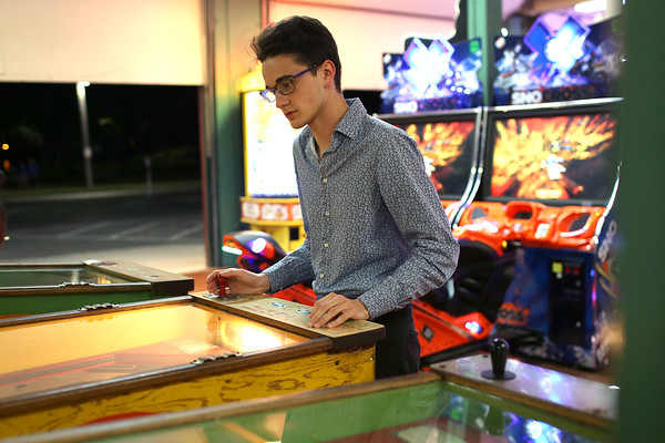"""HADLEY GREEN/Staff photo<br /> Thomas Rutigliano, 18, of Beverly, plays pinball at the Willows arcade. Rutigiliano says he frequently comes to the Willows. """"It's kind of like a time capsule. I feel like there's not a lot of arcades anymore,"""" he says.<br /> <br /> 08/31/17"""