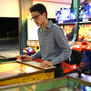 "HADLEY GREEN/Staff photo<br /> Thomas Rutigliano, 18, of Beverly, plays pinball at the Willows arcade. Rutigiliano says he frequently comes to the Willows. ""It's kind of like a time capsule. I feel like there's not a lot of arcades anymore,"" he says.<br /> <br /> 08/31/17"