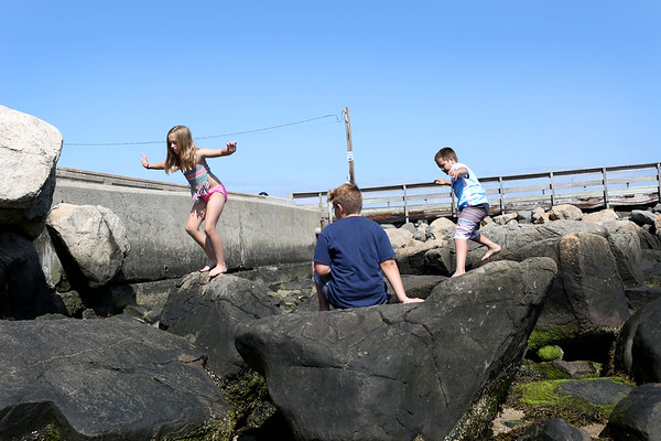 HADLEY GREEN/Staff photo<br /> Carsyn Bradley, Charlie Bradley, and Morgan Gilman play on the rocks at the Willows beach. <br /> <br /> 08/31/17