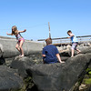 HADLEY GREEN/Staff photo<br /> Carsyn Bradley, Charlie Bradley, and Morgan Gilman play on the rocks at the Willows beach. <br /> <br /> 08/31/17