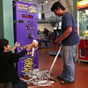 HADLEY GREEN/Staff photo<br /> Brandon Roun, 15, counts his tickets with his step brother Khaivon Keth, 8, at the Salem Willows arcade. <br /> <br /> 08/31/17