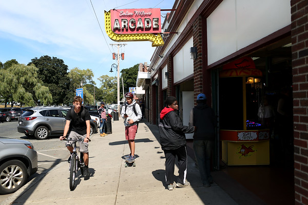 HADLEY GREEN/Staff photo<br /> People bike, skateboard, and walk through the Salem Willows arcade and restaurants on a sunny day at the end of the summer. <br /> <br /> 09/01/17