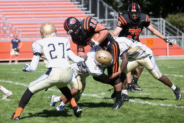 HADLEY GREEN/Staff photo<br /> Beverly's Clayton McAlpine (12) barrels over Malden defenders at the Beverly v. Malden boys varsity football game held at the Hurd Stadium in Beverly. <br /> 09/23/17