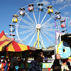 HADLEY GREEN/Staff photo<br /> People walk through the midway at the Topsfield Fair.<br /> 09/29/17