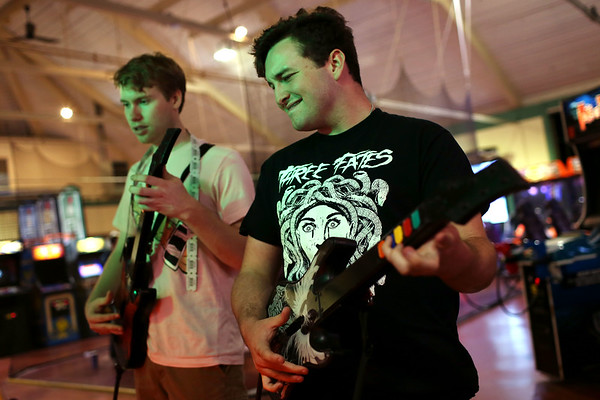 """HADLEY GREEN/Staff photo<br /> From left, Ben Rich, 20, and Ciaran Moore, 19, both of Beverly, play Guitar Hero at the Willows arcade. Both are going off to college in a few days and are making their """"last memories.""""<br /> <br /> 08/31/17"""