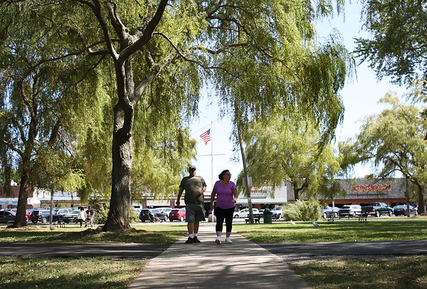 """HADLEY GREEN/Staff photo<br /> Kathy Hanlon and Joe Santoro walk through the Willows. Joe has worked as a mechanic at the park for four years and thinks it's """"excellent."""" <br /> 09/01/17"""