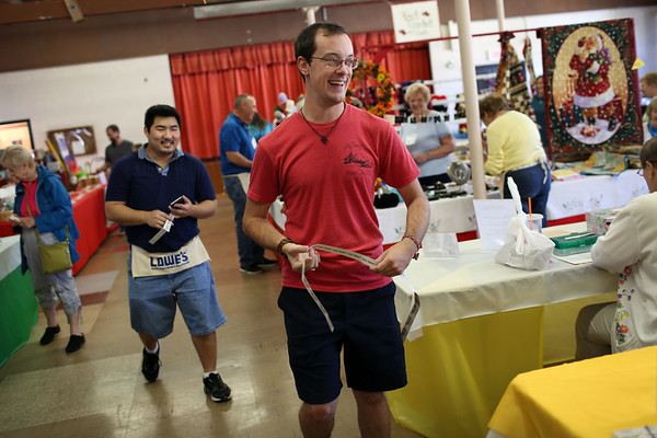 HADLEY GREEN/Staff photo<br /> Brian Kirby of Salem smiles after winning a $60 prize at the St. Anne's Church bazaar.<br /> 09/23/17