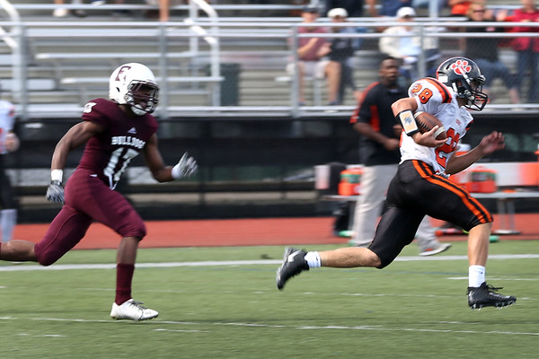 HADLEY GREEN/Staff photo<br /> Beverly's Clark Marchand (28) runs with the ball to score a touchdown while Lynn's Seth Lukindo (17) runs behind him at the Lynn English v. Beverly football game at the Manning Field in Lynn.<br /> 09/09/17