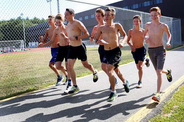 HADLEY GREEN/Staff photo<br /> Peabody High cross country runners begin a practice run from the turf field.<br /> 08/31/17