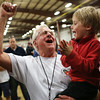 HADLEY GREEN/Staff photo<br /> Woody Lancaster of Topsfield celebrates with his grandson Ryan Lancaster after winning the Giant Pumpkin Weigh-Off at the Topsfield Fair with his 2,003.5 pound pumpkin. <br /> 09/29/17