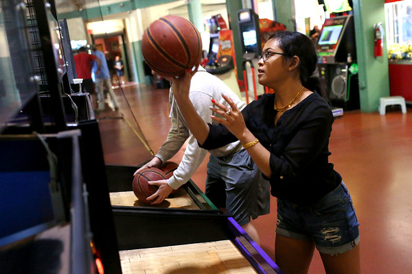 HADLEY GREEN/Staff photo<br /> Vanessa Pao and Connor Robertson of Lynn enjoy the Salem Willows arcade on a Thursday night. <br /> <br /> 08/31/17