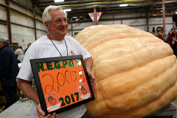 HADLEY GREEN/Staff photo<br /> Woody Lancaster of Topsfield stands next to his winning pumpkin at the Giant Pumpkin Weigh-Off at the Topsfield Fair.<br /> 09/29/17