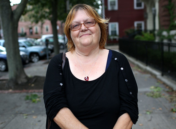 HADLEY GREEN/Staff photo<br /> Stephanie Moffat stands in downtown Salem, where she used to work before moving to St. Thomas. Moffat is staying at a friend's home in the area after being displaced by Hurricane Irma. <br /> 09/21/17
