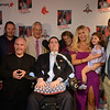 "RYAN HUTTON/ Staff photo<br /> Beverly native and ALS sufferer Pete Frates, center, is surrounded by Boston Mayor Marty Walsh, far left, authors Casey Sherman and Dave Wedge left, his wife Julie and daughter Lucy, 3, right brother Andy and mother Nancy, far right, at the State Street Pavilion at Fenway Park on Monday night for an event to support the book about him ""The Ice Bucket Challenge"" - a chronicle of his struggles with ALS and how he helped start the famed ice bucket challenge to raise money for ALS research."