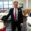 HADLEY GREEN/Staff photo<br /> Brian Kelly of Kelly Automotive Group stands in the showroom of his Infinity dealership on Andover Street in Danvers.<br /> 09/22/17