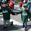 HADLEY GREEN/ Staff photo<br /> Brothers Adrian and Jack Cardoza link hands as they walk down the street during the Salem Little League parade from Salem State's O'Keefe Center to the Stephen O'Grady Field on Sunday, April 30th, 2017. Both are players on the Jets T-ball team.