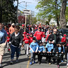 HADLEY GREEN/ Staff photo<br /> Teams marched in the Salem Little League parade from Salem State's O'Keefe Center to the Stephen O'Grady Field on Sunday, April 30th, 2017.