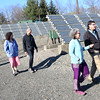HADLEY GREEN/ Staff photo<br /> People walk through the Greenergy Park Solar Field on Friday, April 14th, 2017. Local and state environmental groups gathered at the park Friday afternoon to discuss new clean energy initiatives.