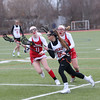 HADLEY GREEN/ Staff photo<br /> Beverly's Darcey McAuliffe (16) runs with the ball while Masco's Marissa DeLucia (11) and Nicole Amyouny (20) guard her during the Masco v. Beverly girls varsity lacrosse game at Beverly High on Friday, April 7th, 2017.
